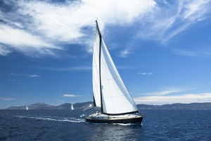 RYA yacht under full sail