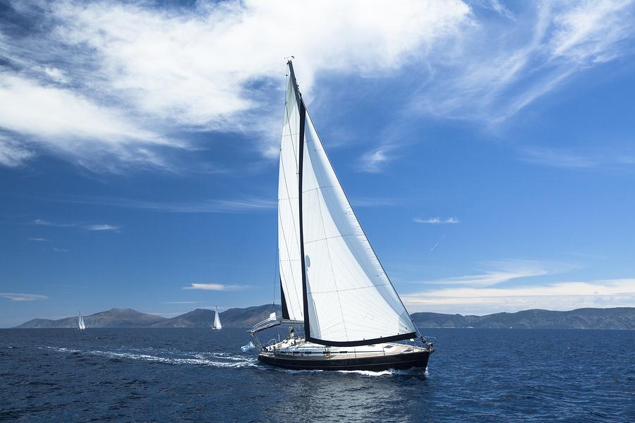 RYA yacht under full sail