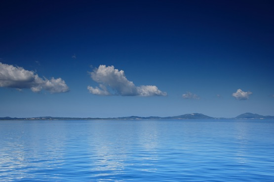 view of an open sea with a cloud on corfu island greece